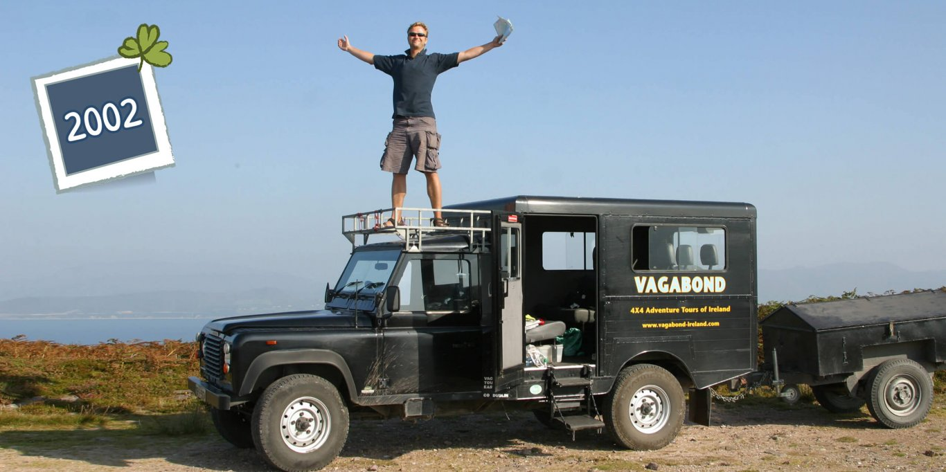 Vagabond Tours Founder, Rob Rankin, standing on top of an original VagaTron Land Rover tour vehicle in 2002