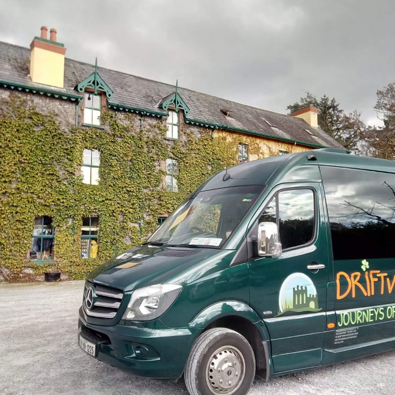 Driftwood tours Drifter tour vehicle outside a leafy building in Ireland