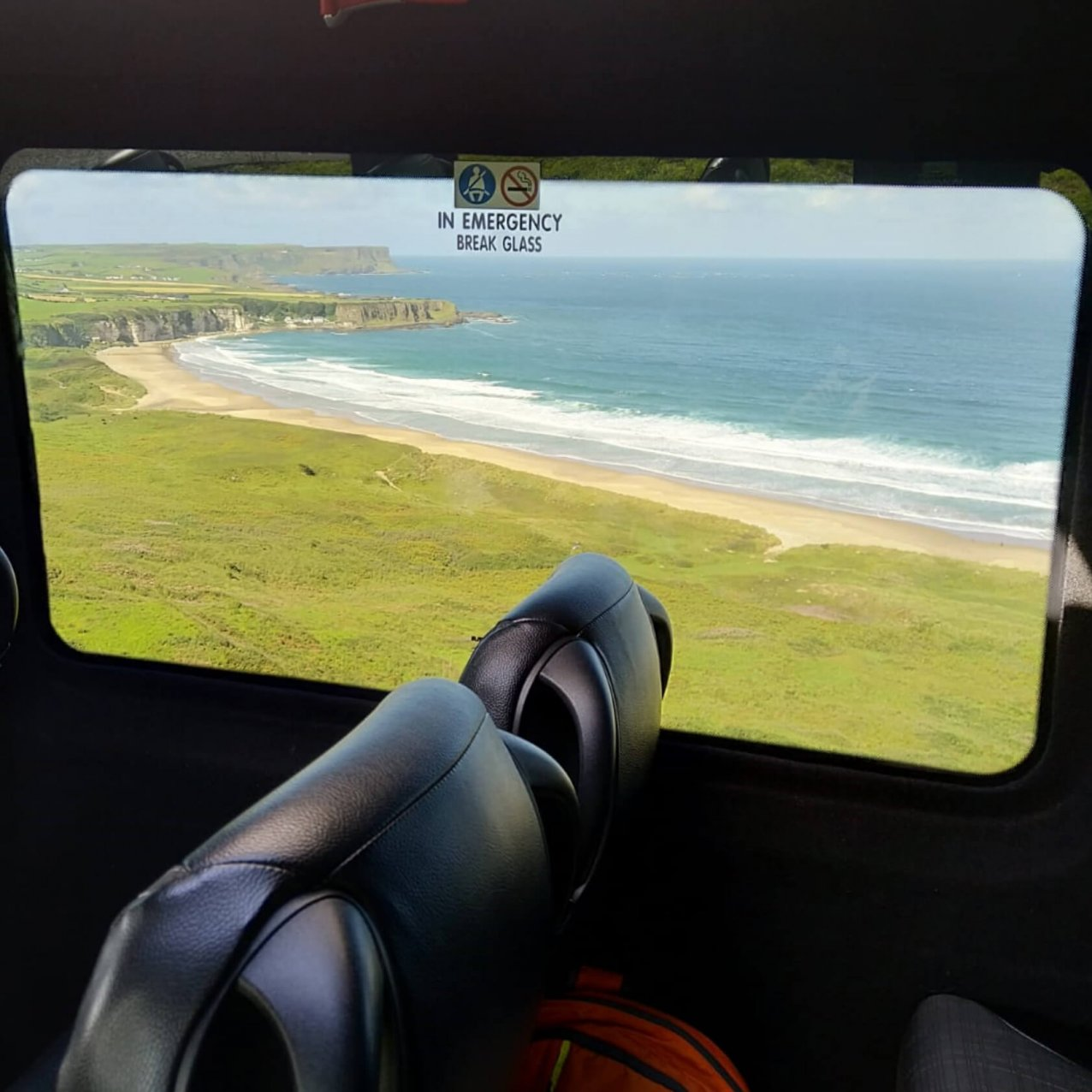 Interior view of a scenic beach in Ireland from a Driftwood tours Drifter tour vehicle