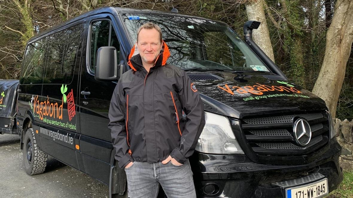 Rob Rankin, Managing Director of Vagabond Tours of Ireland with a tour vehicle