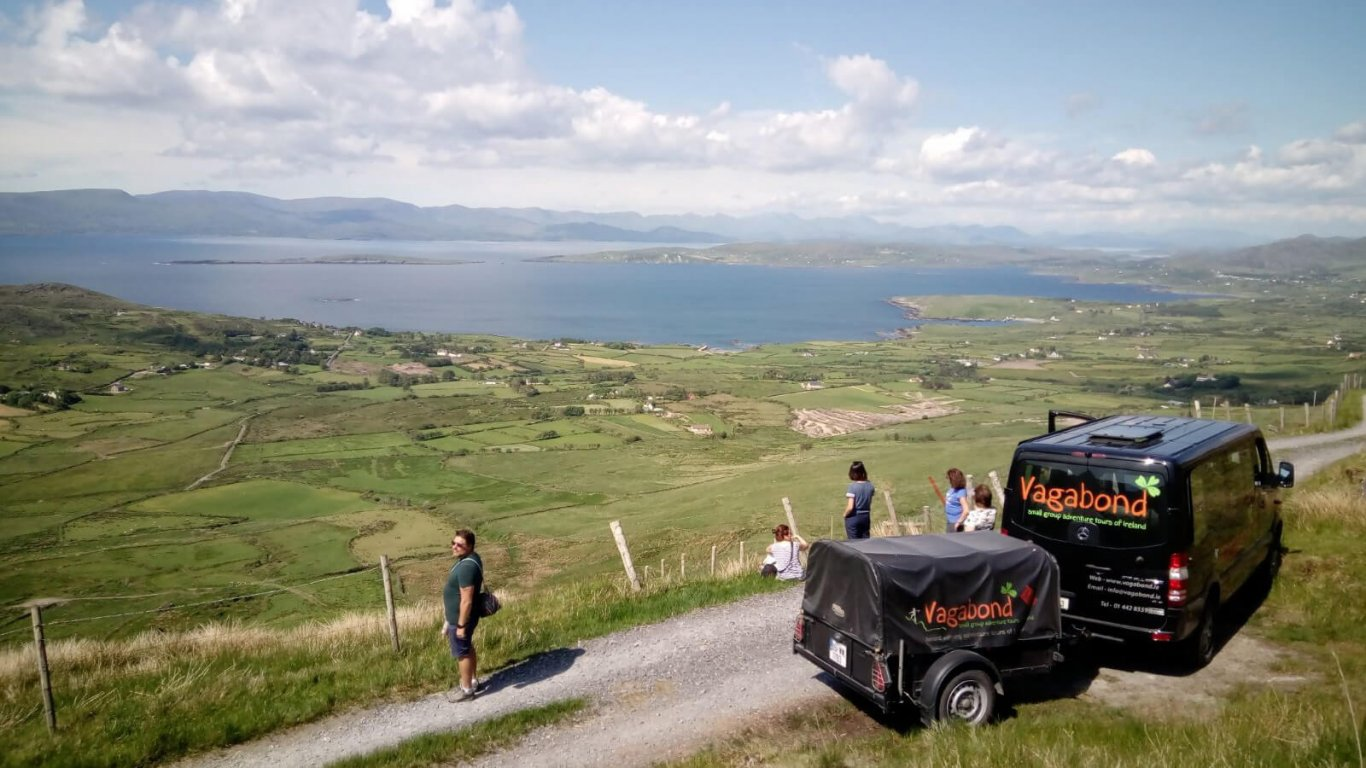 Vagabond tour vehicle and tour group stopped at a scenic spot on the Beara Peninsula, Ireland