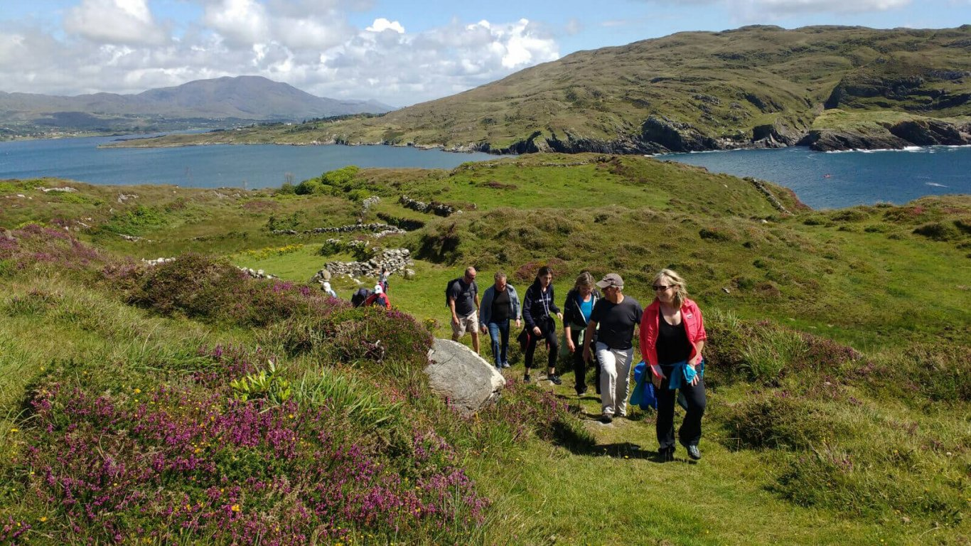 Vagabond tour guests hiking near Dunboy Castle on the Beara Peninsula, Ireland