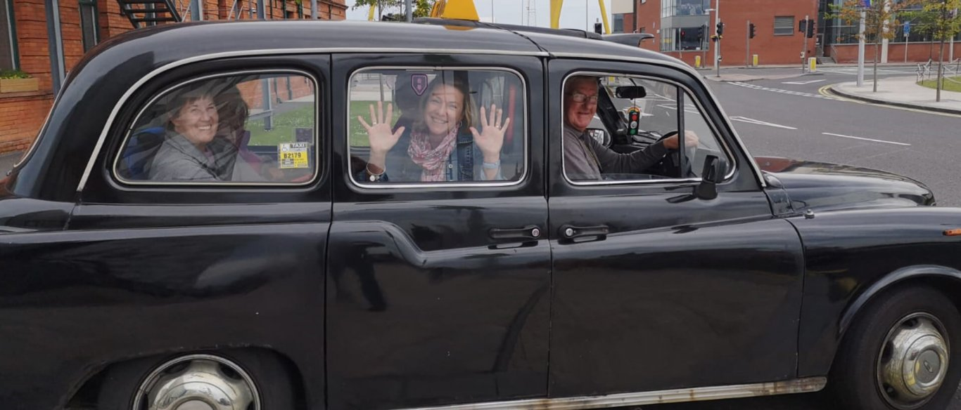Vagabond Tour group setting off on a Black Cab tour of Belfast, Northern Ireland