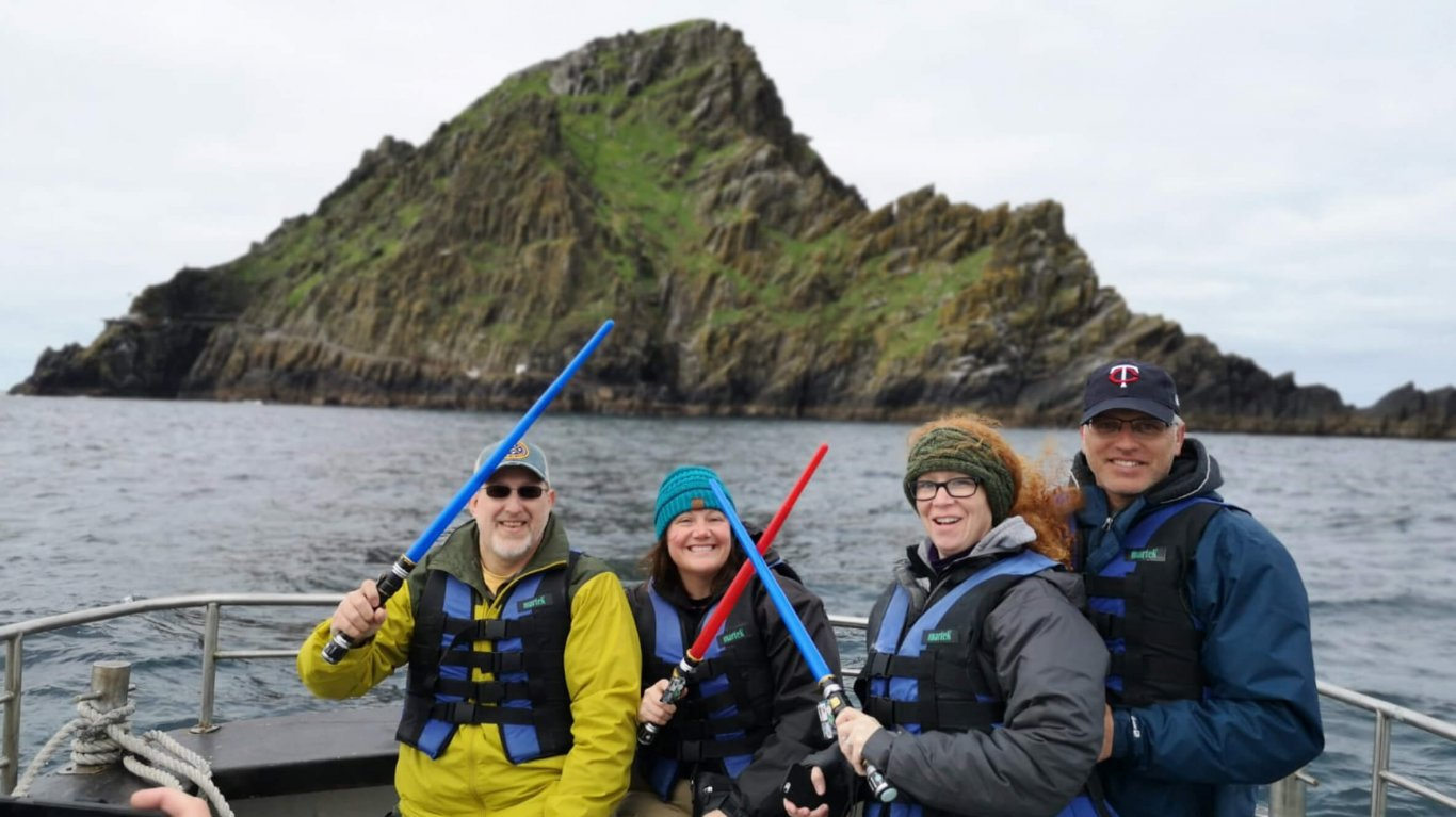 Four tour guests take a boat trip to the Skellig Islands
