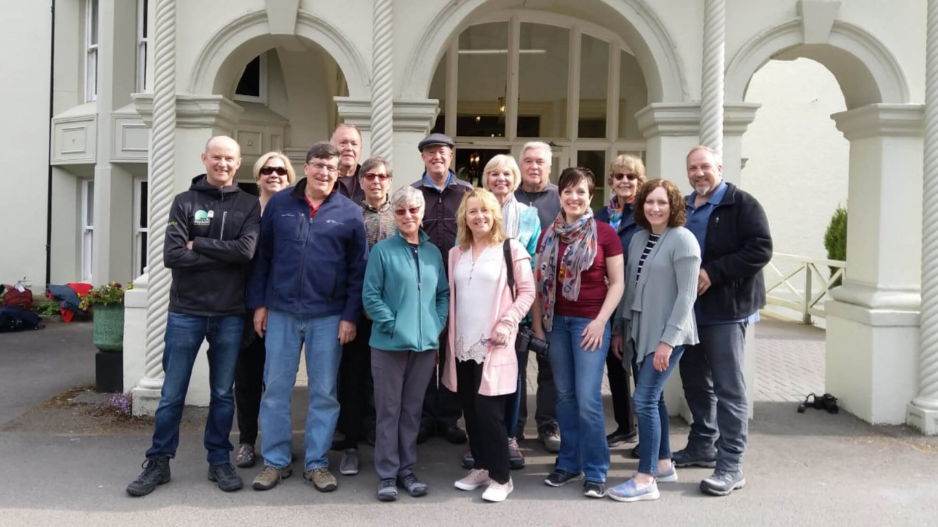 Group shot of Mark's Driftwood tour group outside Beech Hill Country House Hotel in Northern Ireland