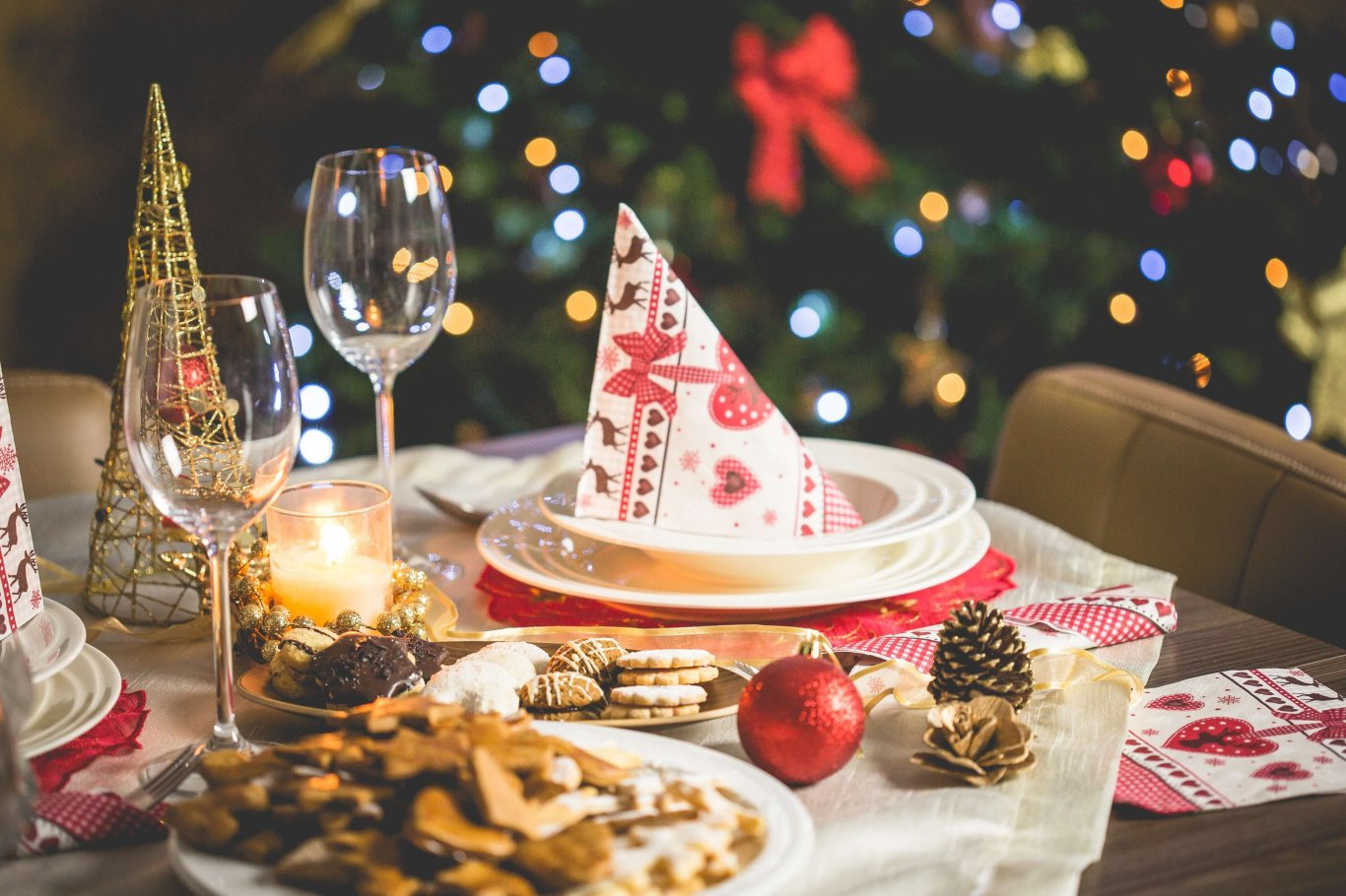A Christmas themed table with cookies and decorations