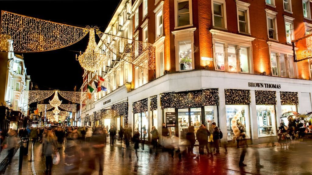Crowds shopping at night on a lit up Grafton Street