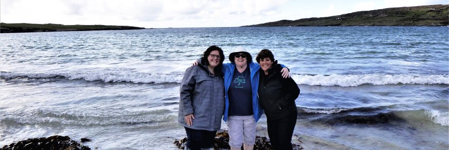 Three tour guests on a beach in Ireland