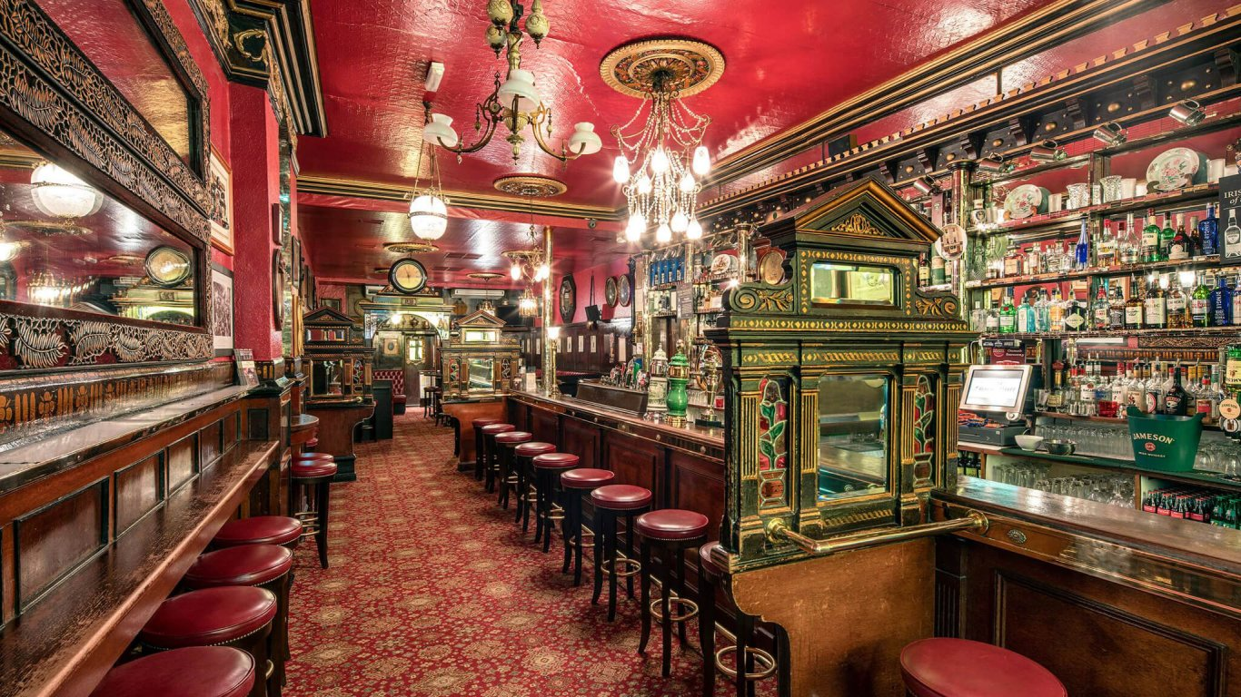 The colorful antique interior of the Long Hall Pub in Dublin, Ireland