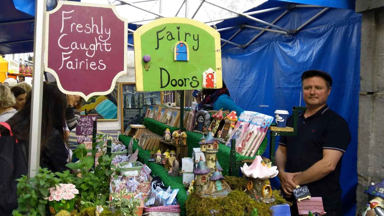 Selling fairy doors at a market in Ireland
