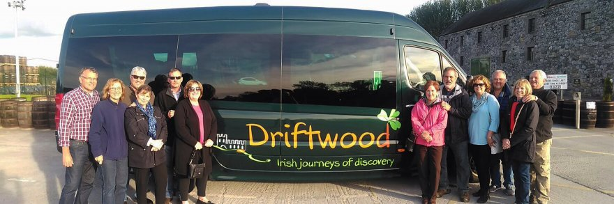 Driftwood guests posing in front of a Driftwood bus