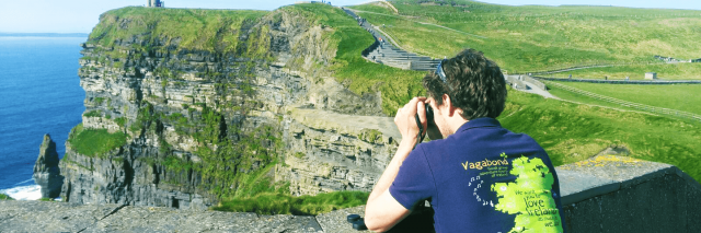 Vagaguide Henry taking a picture of the Cliffs of Moher