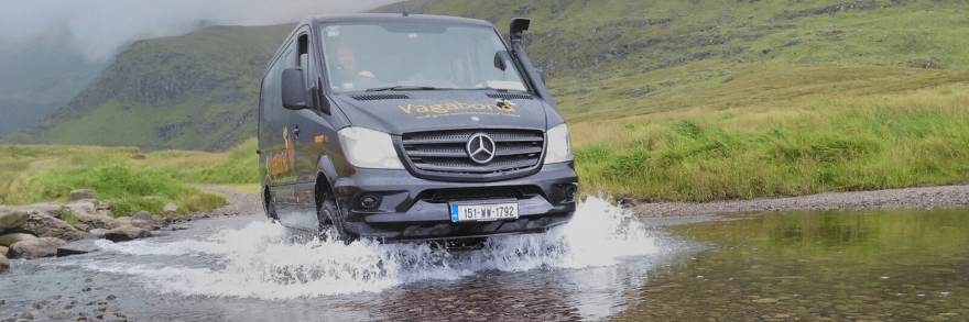 The Vagatron going off the beaten path in Dingle going through a shallow river in a valley
