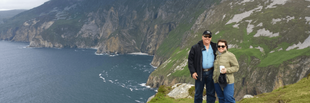A couple posing at Slieve League along the Wild Atlantic Way