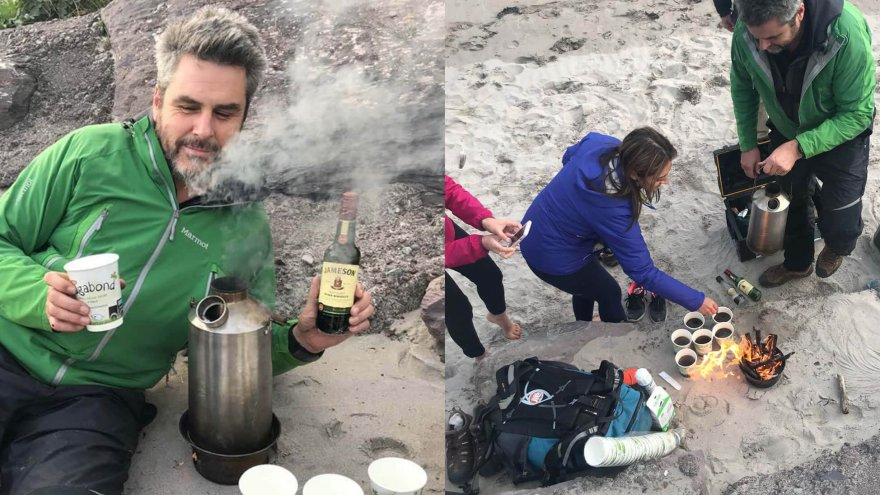 VagaGuide Tim makes a wild irish coffee on a beach with his group in Ireland