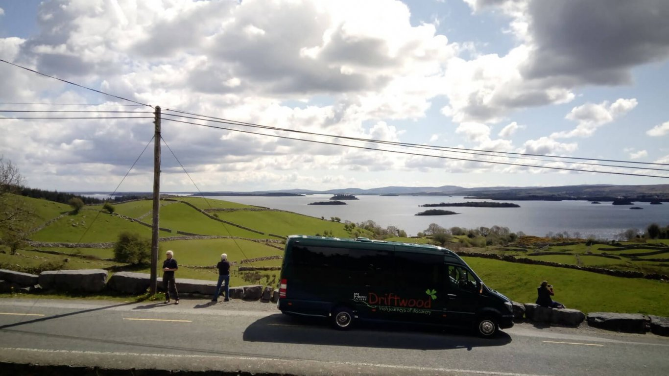 A Drifter tour vehicle stops at Lough Corrib in Ireland