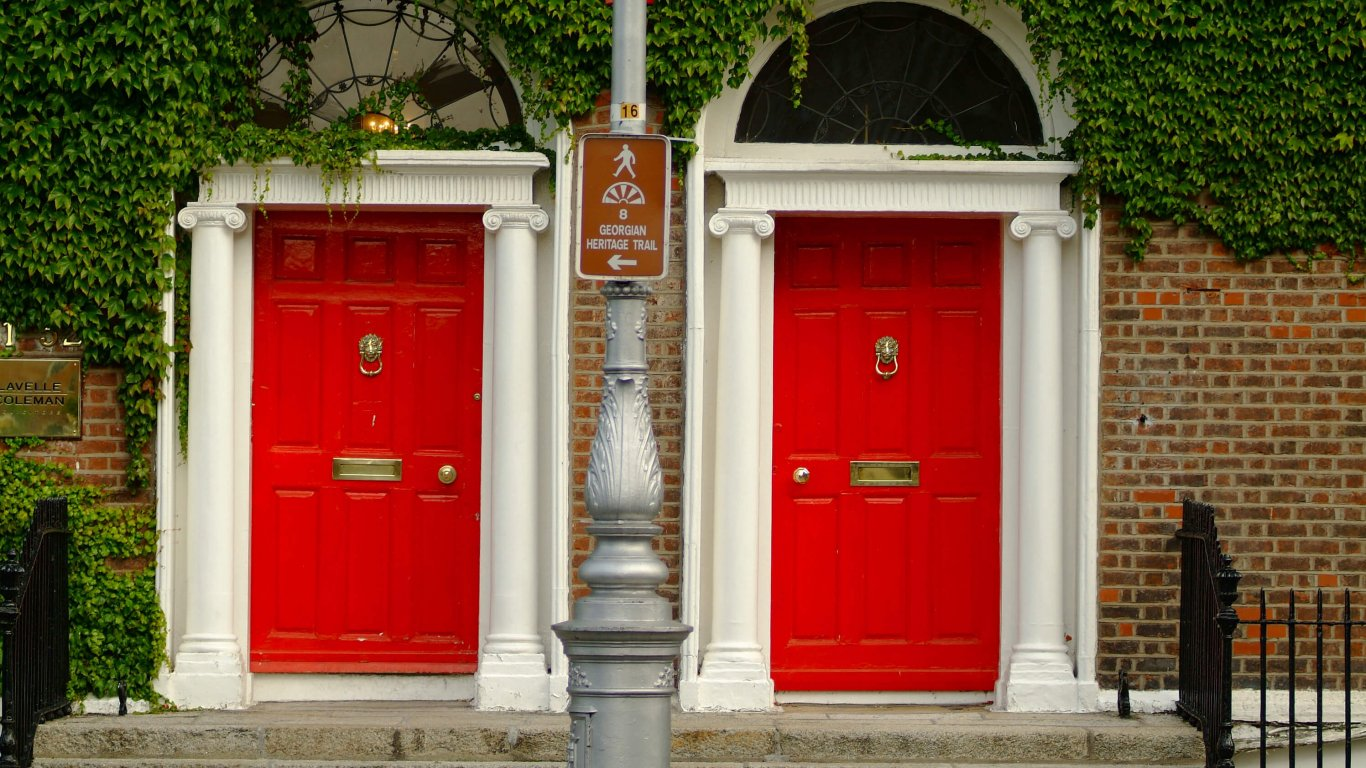 Two Georgian red doors in Dublin beautifully covered in Ivy