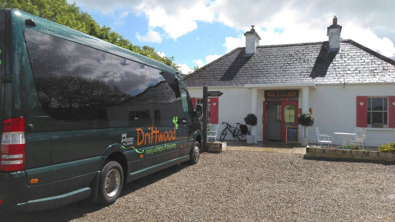Driftwood Drifter tour vehicle parked outside cottage in Ireland
