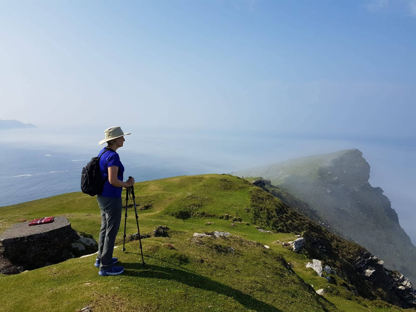 Female guest hiking in Ireland at Bray Head on Valentia Island in Kerry