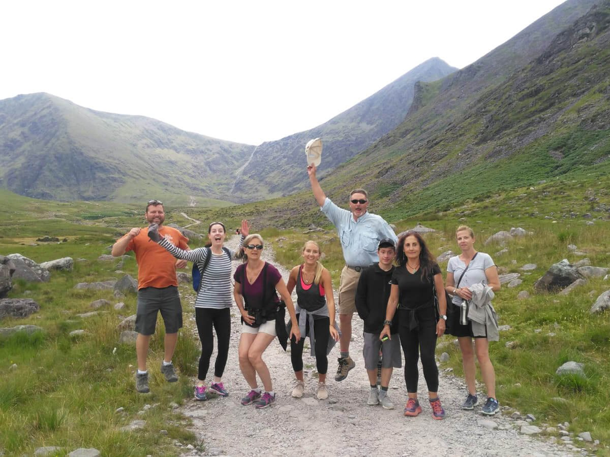 Tour group hiking in Ireland at Carauntoohil in Kerry