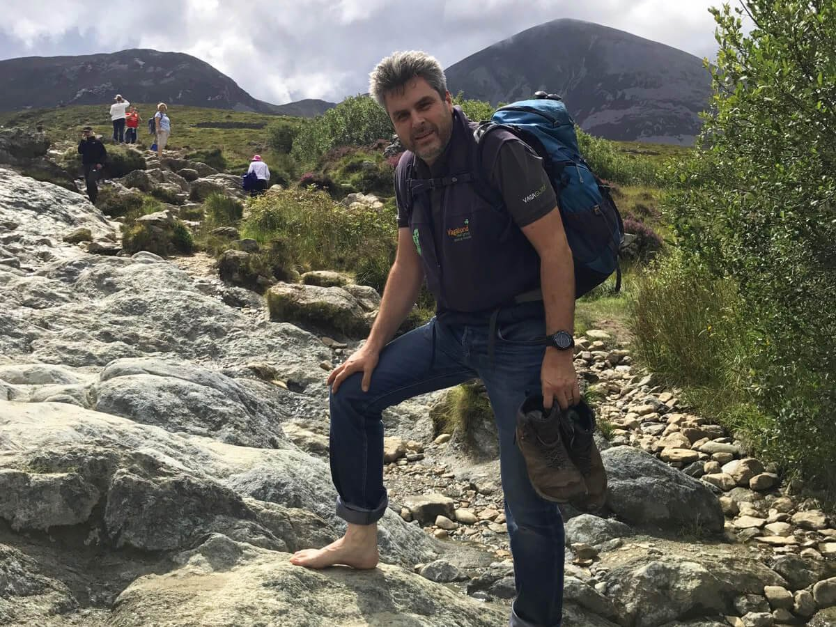 VagaGuide Tim hiking in Ireland at Croagh Patrick in Mayo without shoes on