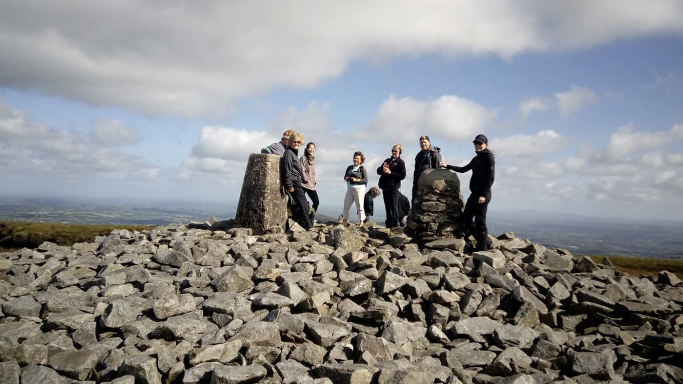 Vagabond group atop slieve gullion surrounded by rocks