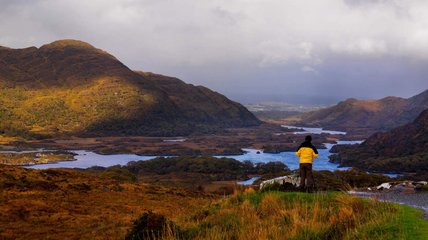 A man standing at ladies view over looking Killarney National Park