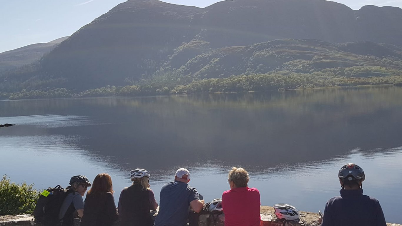 Tour group looking at a scenic lake in Killarney National Park in Ireland