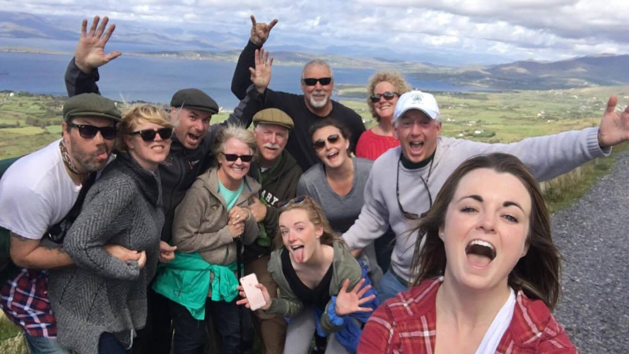 A happy and exuberant Vagabond tour group pose for a selfie in Ireland