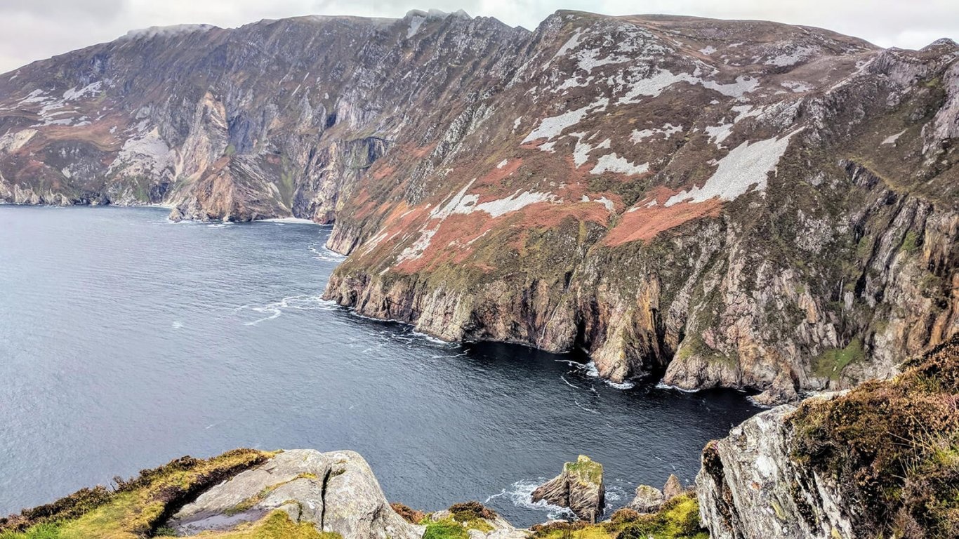 A scenic view of the Slieve League cliffs and the Atlantic Ocean