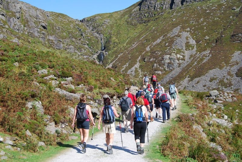 A Vagabond tour group setting off on their hike through the Comeragh mountains in the sunshine