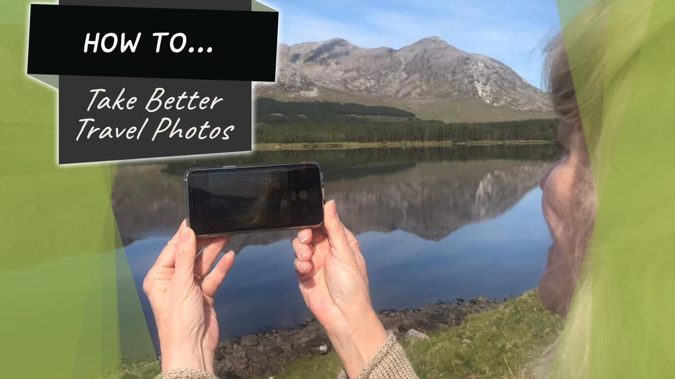 Graphics overlaid a lady taking a photo with her phone of a scenic lake and mountain in Ireland