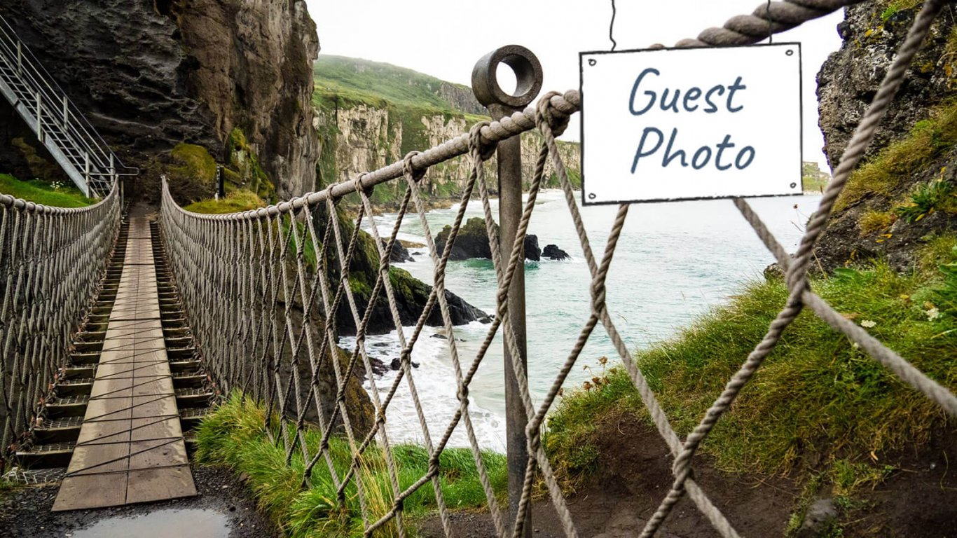 Guest photo of Carrick a rede rope bridge in Northern Ireland with guest photo graphic overlaid