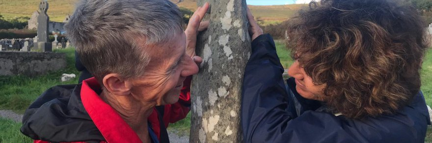 A couple renew their vows at the Ogham stone near Dingle, Ireland