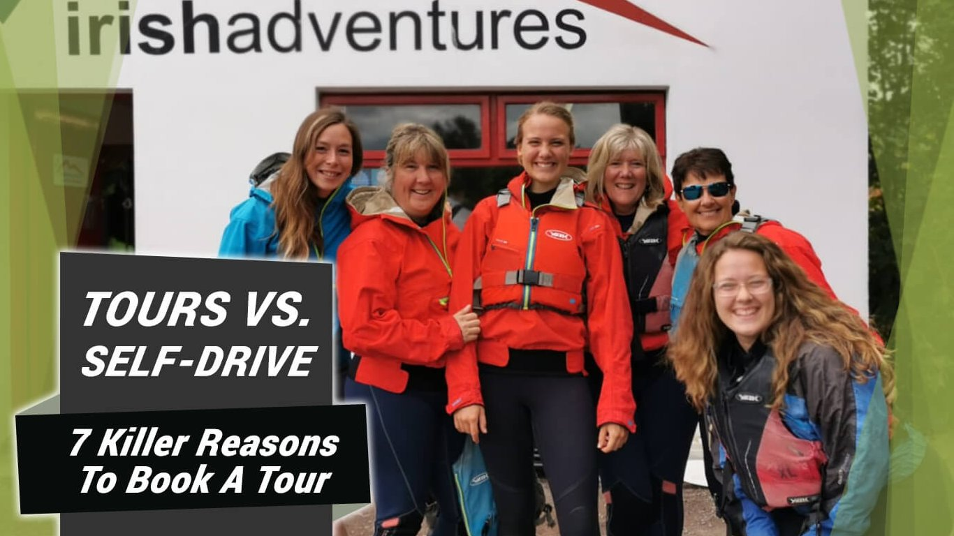 Happy group of female Vagabond tour guests pose at a kayaking centre