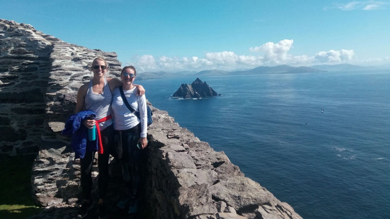 Two friends at the summit of Skellig Michael with a view of Skellig Beag in the distance