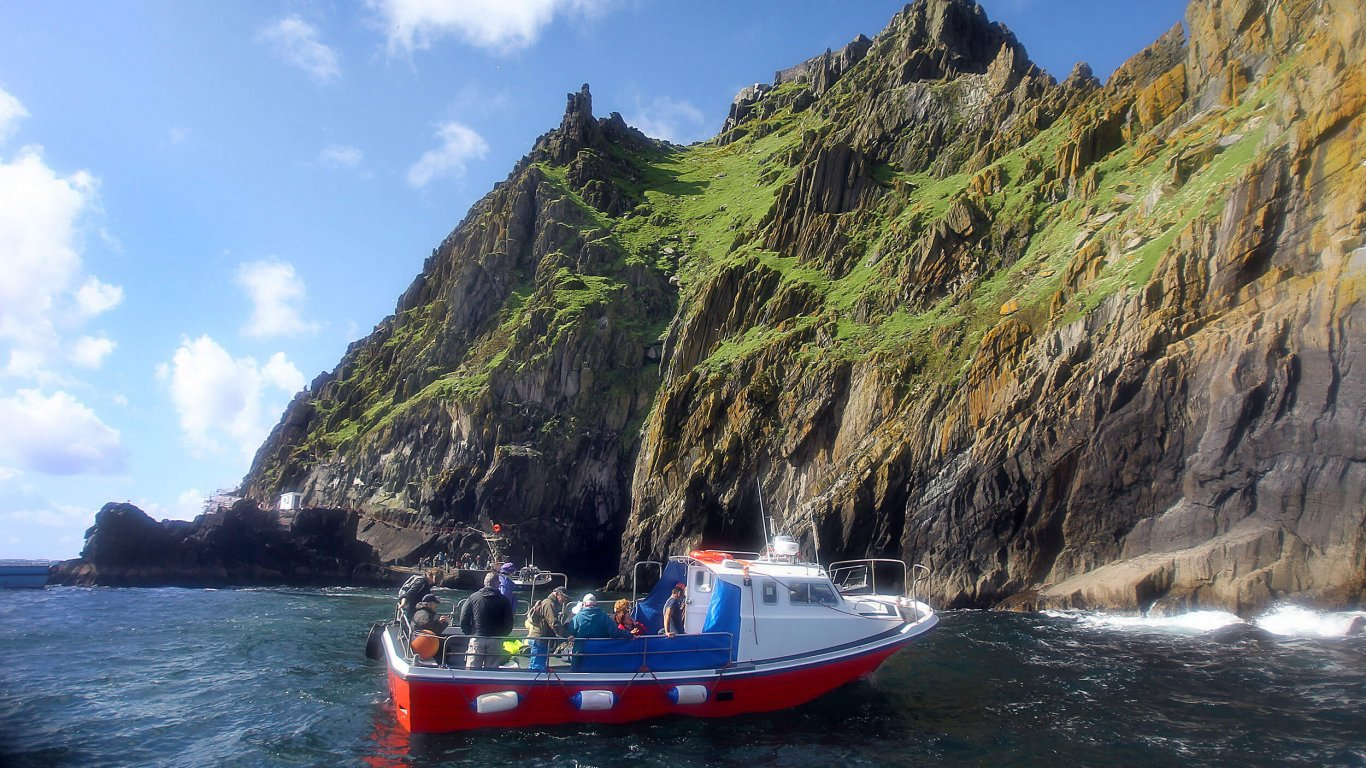 A boat taking a trip around the Skellig Islands with a view of Skellig Michael