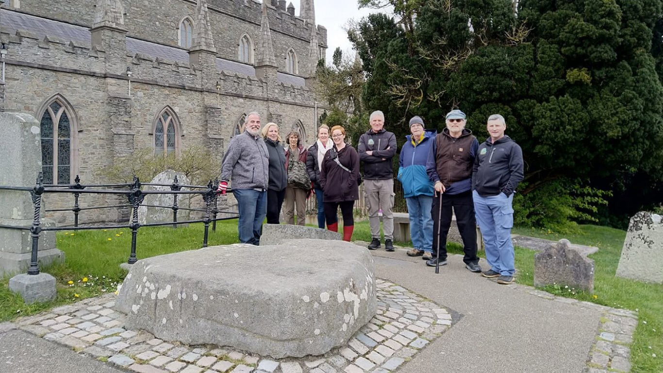 A driftwood group visiting the grave of St Patrick