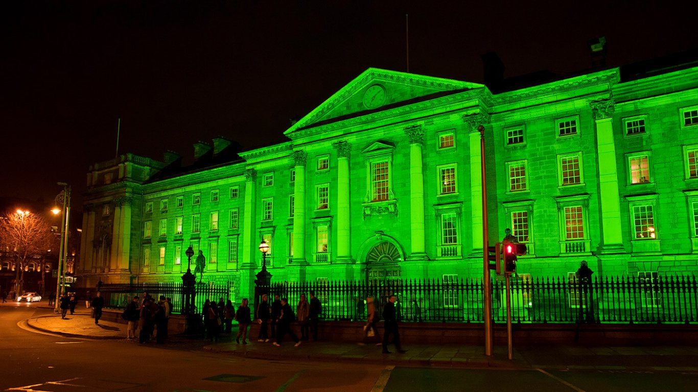 Trinity College Dublin lit up in green for st patricks day
