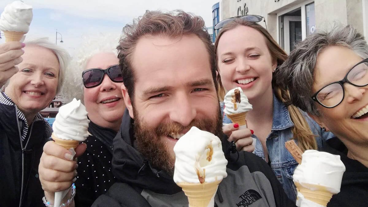 Tour group eating 99 ice creams during summer in Ireland