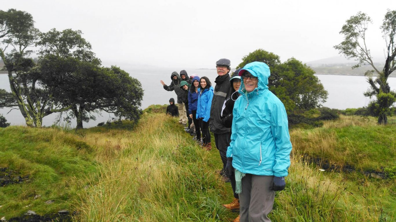 Smiling Vagabond tour group hiking in Ireland in rainy weather