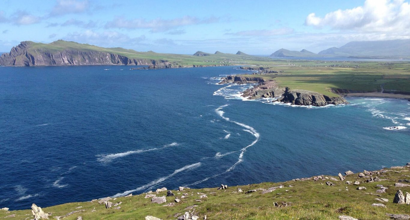 A view of Slea Head on the Dingle peninsula and a view of the three sisters mountains in the distance