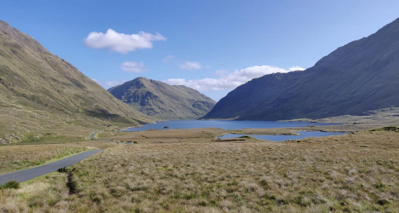 The doolough valley and lake under blue skies