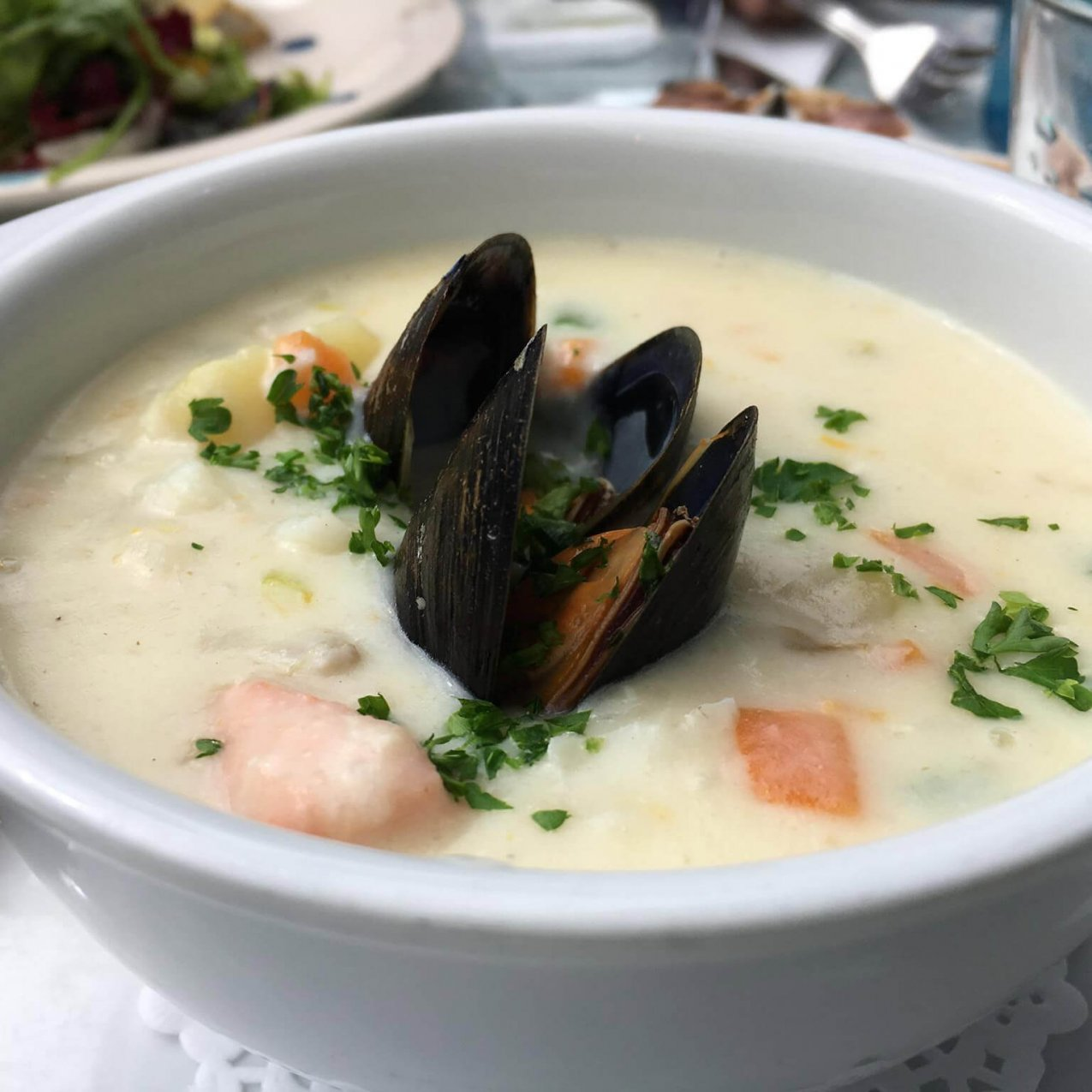 Creamy seafood chowder featuring mussels and herbs