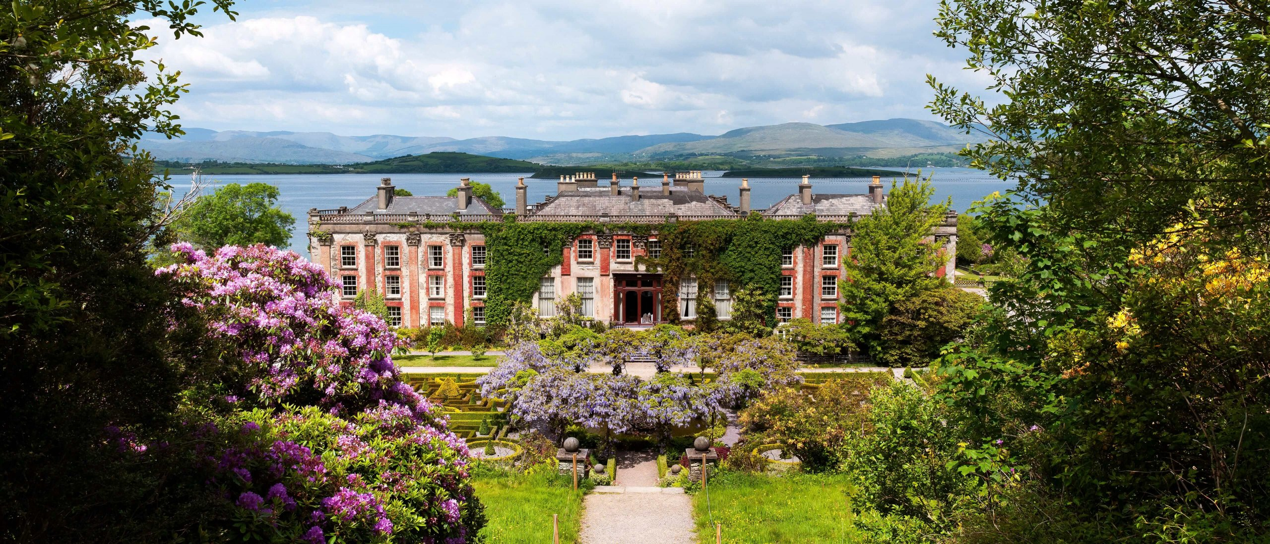 Bantry House Gardens in Ireland with scenic mountain and sea view in the background
