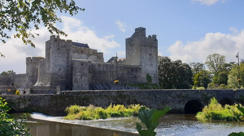 A scenic shot of Cahir Castle and the River Suir in Ireland