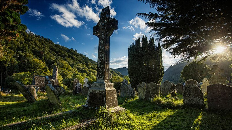 Graveyard and cross in Glendalough, Ireland