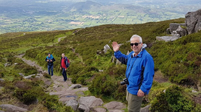 Three Vagabond tour guests hiking on Slieve Gullion mountain in Northern Ireland