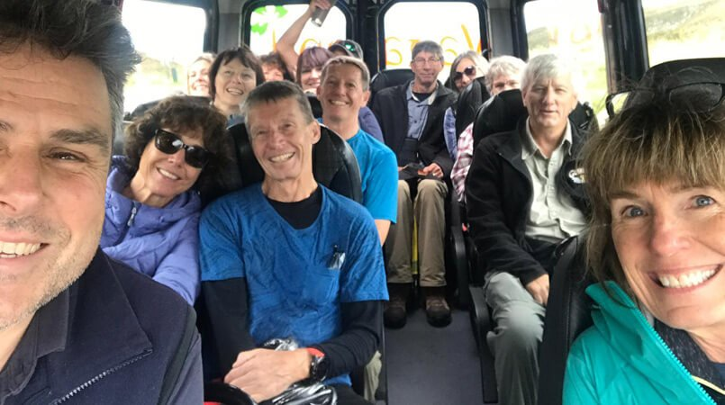 Smiley selfie on a tour vehicle with a happy Vagabond tour group in Ireland