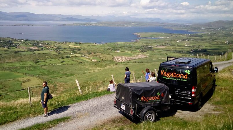 A VagaTron tour vehicle parked up at a scenic spot on the Beara peninsula in Ireland with passengers